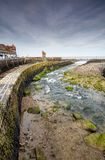 East Lyn river at Lynmouth harbour, Devon. The East Lyn river runs parallel to Lynmouth harbour, which curves and flows into the Bristol channel. The Rhenish royalty free stock photography