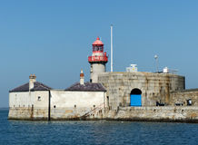 The East Pier Lighthouse and dwelling in Dunlaoghaire harbour Royalty Free Stock Photo