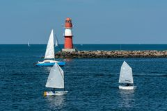 East pier with red beacon in Warnemuende royalty free stock photo