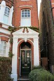 East Putney home entrance. A street in London East Putney. Old houses restored looking almost the same and keeping a vintage look stock image