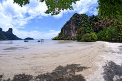 East Railay bay at low tide. The East Railay beach is swimmable only at high tide stock image