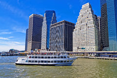 East River ferry boat in front of the majestic Lower Manhattan b Royalty Free Stock Images