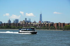 East River ferry boat rides in Midtown Manhattan Royalty Free Stock Photography