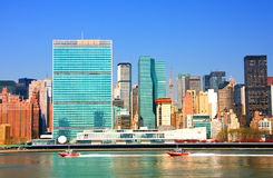 East River and United Nations Building. View of the east river and Manhattan skyline featuring the United Nations building stock photos