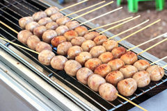 East sausage being grilled Royalty Free Stock Photo