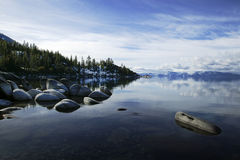 East Shore Lake Tahoe. This shot shows the wonderful rocks on the east shore of Lake Tahoe. The glassy early fall water reflexes the snow covered peaks on the royalty free stock photo