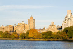 East Side of central park during the fall. Views of the Upper East side from the South side of the Central Park Reservoir during an autumn evening stock image
