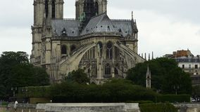 East side of Notre-Dame cathedral, gothic style architecture, panorama view. Stock footage stock video footage