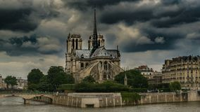 East side of Notre-Dame de Paris under dark overcast sky, gothic architecture. Stock footage stock video
