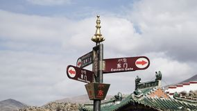 East sign and another directions with Chinese and Tibet language stock photography
