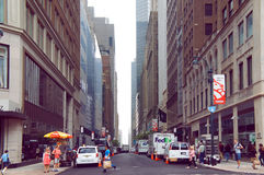 East 41 Street on summer workday in the New Yourk City. New York, United States - June 15, 2015: People and cars move alongside the busy East 41 Street on summer Royalty Free Stock Photography