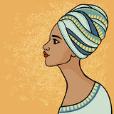 East suntanned girl in a traditional turban. Profile view. Royalty Free Stock Photo
