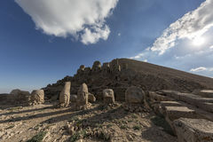 East terrace of Mount Nemrut, Turkey. Adiyaman, Turkey - May 27, 2017: Statues of East terrace at Mount Nemrut on May 27, 2017. The UNESCO World Heritage Site at Stock Photography