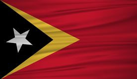 East Timor flag vector. Vector flag of East Timor blowig in the wind. EPS 10 Stock Photography