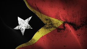East Timor grunge dirty flag waving on wind. East Timorese background fullscreen grease flag blowing on wind. Realistic filth fabric texture on windy day Stock Photos
