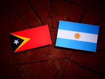 East Timorese flag with Argentinian flag on a tree stump isolate Royalty Free Stock Photo