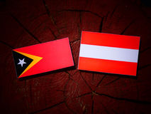East Timorese flag with Austrian flag on a tree stump  Stock Image