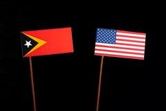 East Timorese flag with USA flag  on black Stock Photography