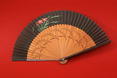 East traditional fan. Isolated on red background Stock Photography