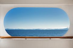 East view across Queen Charlotte Sound, BC, Canada through crusie ship window. royalty free stock photo