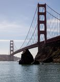 East view Golden Gate Bridge. From the east side of the Golden Gae the sharp rocks of San Francisco bay make a treacherous entry for ships. On this day a small Stock Photography
