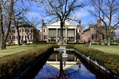 East View of the McCormick House. This is a Winter picture of the Eastside of the iconic Robert R. McCormick House and reflecting Pond in Cantigny Park located Royalty Free Stock Photo