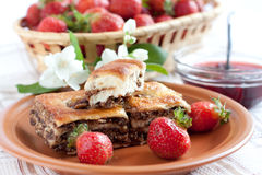 East walnut baklava and fresh strawberries. Sweet and delicate dessert Stock Photo
