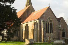 East Window. Of ancient church, seen from outside, with a foreground of ancient tombs Royalty Free Stock Photo