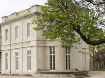 East Wing of Dundurn Castle in Hamilton, ON, Canada. With a view from the park with a tree branch coming into the scene from the right edge of the frame stock photo