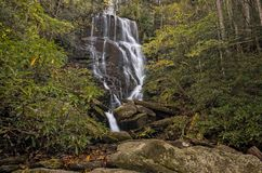 Eastatoe Falls Waterfall. Eastatoe Falls is a beautiful 60 foot waterfall near Rosman North Carolina. Seen here in autumn royalty free stock image