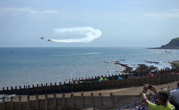 Eastbourne Airshow aerobatics 2016. People enjoying the unique Breitling Wingwalkers team perform a breathtaking sequence of acrobatic manoeuvres with stunt Stock Photos