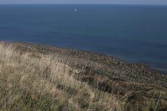Eastbourne, East Sussex, Engeland, het UK - weiden, hemel, overzees stock afbeeldingen