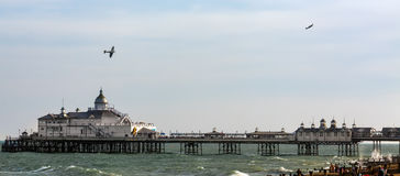 EASTBOURNE, EAST SUSSEX/UK - AUGUST 11 : Dogfight  over the pier Royalty Free Stock Photography