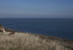 Eastbourne, Engeland, het UK - weiden, hemel, overzees stock afbeeldingen