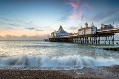 Eastbourne Pier. The beach and pier at Eastbourne on the East Sussex coastline Stock Photo