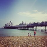 Eastbourne pier. And beach, seaside in the summer Stock Photography