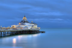 Eastbourne pier in late evening. Basking in beautiful blue light, UK, Europe Royalty Free Stock Photo