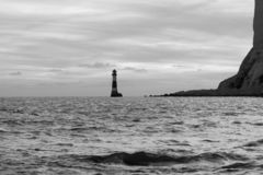 19/09/2018 Eastbourne, United Kingdom. Beachy Head lighthouse. Black and white landscape of the lighthouse during tide off Royalty Free Stock Photos