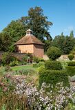 Eastcote House historic walled garden in the Borough of Hillingdon, London, UK. Dovecote in distance.