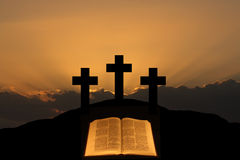 Easter. Three crosses on a hill with a bible in the foreground Stock Photography