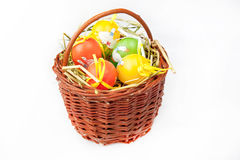 Easter. Painted Colorful Easter Eggs in a bascet on a white background Stock Photos