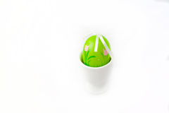 Easter. Painted green Easter Egg in a egg-cup on a white background Stock Images