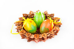 Easter. Painted Colorful Easter Eggs in a bascet on a white background Royalty Free Stock Photo