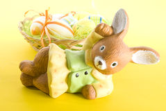 Easter. Bunny in front of a basket with  eggs Royalty Free Stock Images