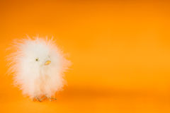 Easter. Chicken decoration on bright orange background Stock Images