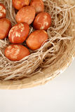 Easter. Colored Easter eggs with straw and Stock Image
