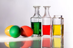 Easter. Coloured easter eggs and small bottles Stock Photography