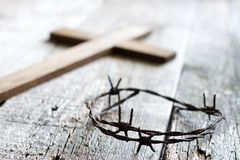 Easter abstract background with crown of thorns and cross on wooden planks. Closeup royalty free stock photos