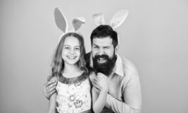 Easter activities for children. Happy easter. Holiday bunny long ears. Family tradition concept. Family dad and daughter. Wear bunny ears. Father and child stock photos