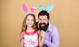 Easter activities for children. Happy easter. Holiday bunny long ears. Family tradition concept. Family dad and daughter. Wear bunny ears. Father and child stock images